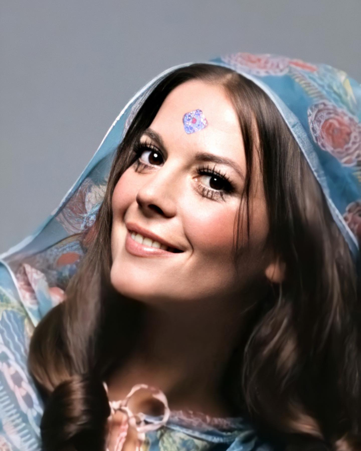 "This is a closeup of the famous photograph by Gianni Penati which shows Natalie wearing a Zandra Rhodes design (Vogue January 1970). Natalie may look carefree but she was also a woman in charge of her career.  The rise of Natalie from a studio-controlled actress to one of Hollywood's most powerful performers is truly an inspiration for all time.  Learn about her passion for family, work and life by watching Natasha's documentary on HBO. A selection of clips from ""Natalie Wood: What Remains Behind"" is available for viewing on our IGTV channel."